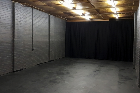 wide open space with black curtains