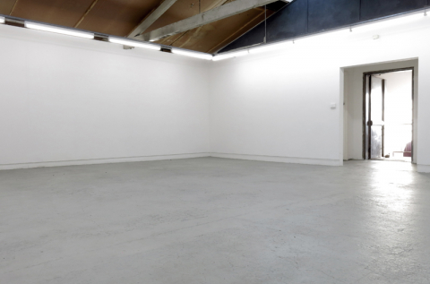 Open shared studio space which is marked out for three studios
