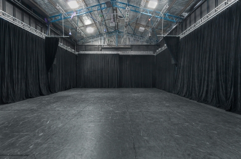 Corporate Space with 5m high Black Drapes