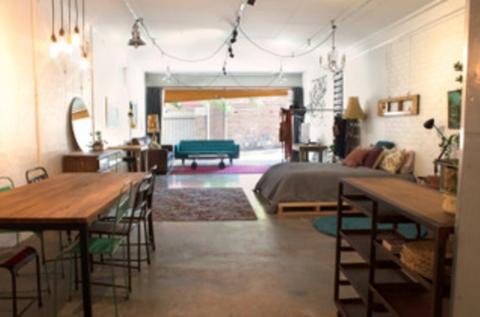 The Garage interior, bifold and roller doors open