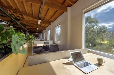 Spacious work desk facing Yarra River